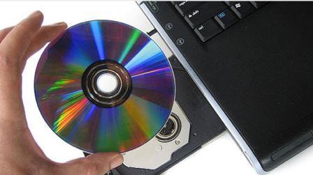 вставить диск в дисковод